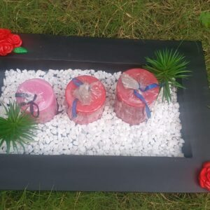 Show piece  With monk, pebbles, flower, candles and black tray