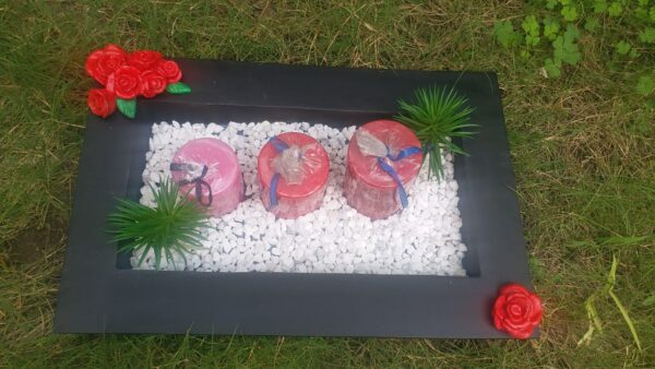 Show piece With monk pebbles flower candles and black tray2
